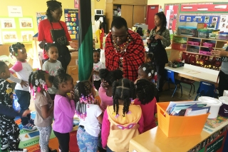 Children at Oglesby greet their special guest.