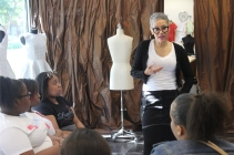 Teens visit fashion designer Barbara Bates.