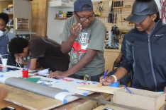 Students work on block club signs for the summer.