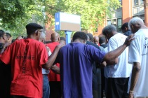 Fathers pray for their children on first day of school.